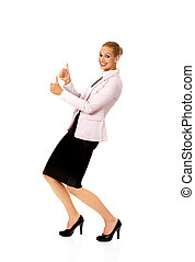 Young happy business woman shows thumbs up