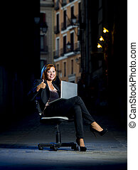 Young Happy Business woman sitting on Office Chair on Street...