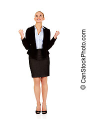 Young happy business woman with arms up