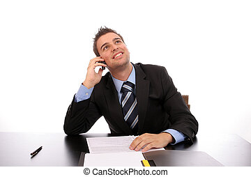 Young happy businessman on the phone