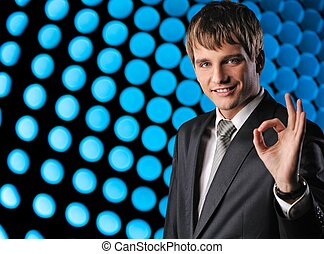 Young happy businessman over abstract background