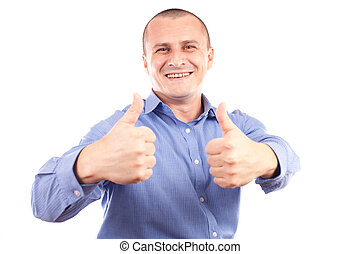 Young happy businessman showing thumbs up sign