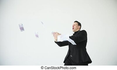 Young happy businessman throwing money. Slow motion. Successful business or winning the lottery. white background