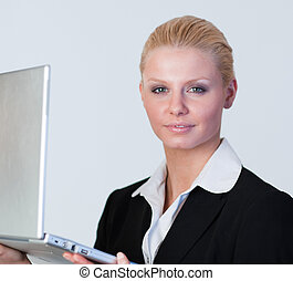 Happy Businesswoman holding a laptop