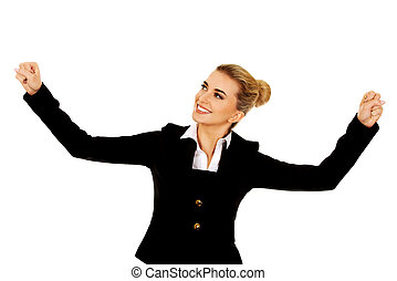 Young happy businesswoman with arms up. Winning concept