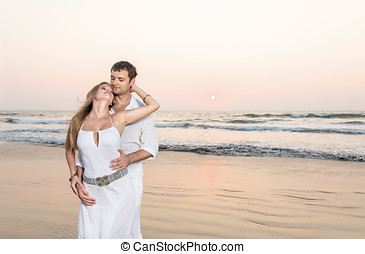 Young happy couple at tropical beach
