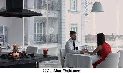 Young happy  couple celebrating with red wine at restaurant