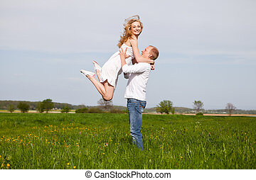 young happy couple have fun in summer