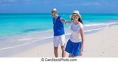 Young happy couple have fun on summer vacation