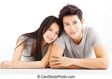 Young happy couple hugging and smiling
