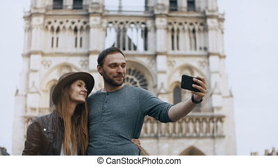 Young happy couple hugging and taking selfie photos on...