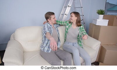 Young happy couple in a new apartment. The concept of buying or rent a new property