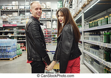 Young happy couple in food supermarket