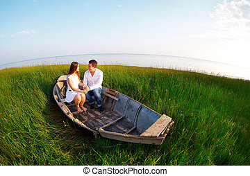 Young happy couple in love. Outdoors portrait