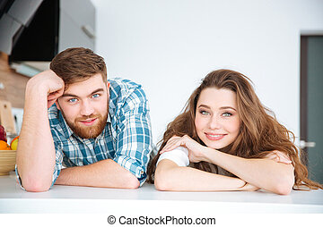 Young happy couple looking at camera