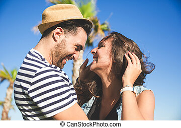 Young happy couple looking at each other laughing