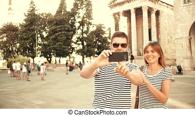 Young happy couple making selfie on vacation