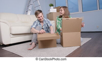 Young happy couple moved a new apartment
