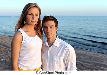 Young happy couple on the beach in summer