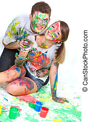 young happy couple painting over white