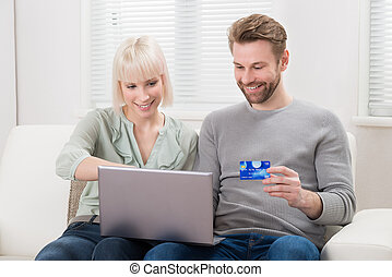 Couple Shopping Online Using Laptop