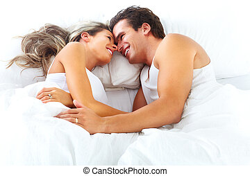 couple - Young happy couple sleeping in bed. Love.