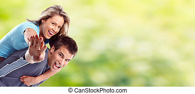 Young happy couple. - Young happy loving couple over green...