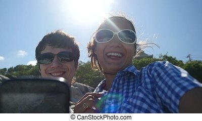 Young happy couple taking selfie portrait by beautiful...
