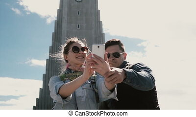 Young happy couple taking the selfie photo on smartphone...