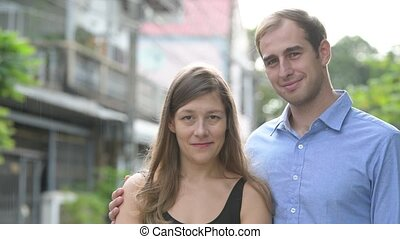 Young happy couple together outdoors