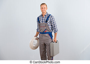 Electrician Holding Cables And Toolbox