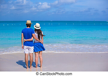 Young happy family on beach vacation