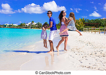 Young happy family with two kids on summer vacation
