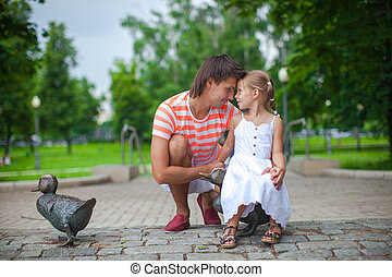 Young happy father with daughter in the park have fun