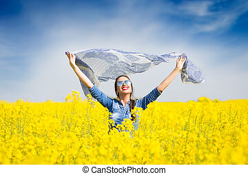 Young happy girl in the field