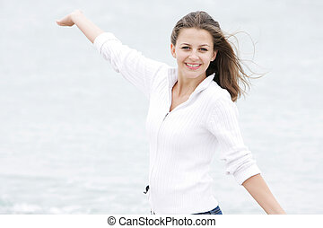 young happy girl on natural background