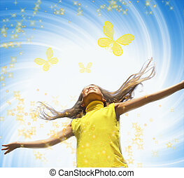 Young happy girl playing with butterflies over abstract background
