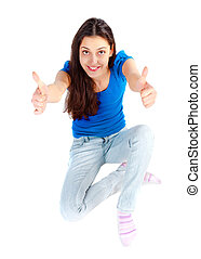 Young happy girl sitting on the floor with thumbs up