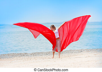 young happy girl with red wings on sea background