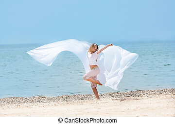 young happy girl with white wings on sea background
