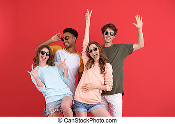 Young happy group of friends standing isolated - Picture of...