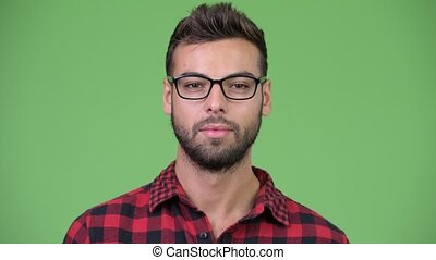 Young happy handsome bearded hipster man smiling - Studio...