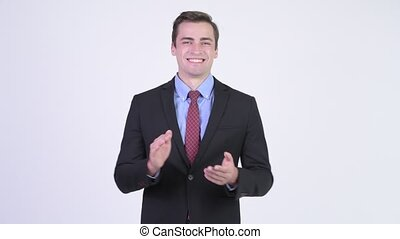 Young happy handsome businessman clapping hands