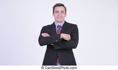 Young happy handsome businessman smiling with arms crossed