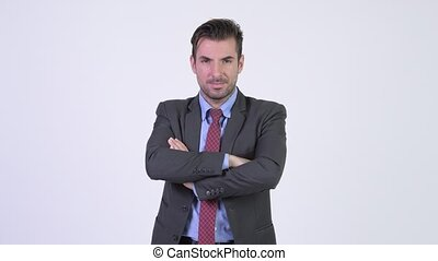 Young happy Hispanic businessman with arms crossed