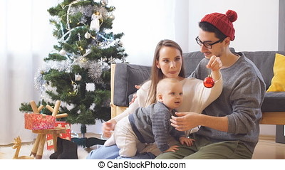 Young happy joyful family. Mother, father and baby boy son...