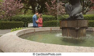 Young, happy, loving couple having date in the park during ...