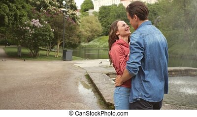 Young, happy, loving couple having date in the park near ...