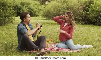 Young, happy, loving couple having date in the park. Relations, friendship and love concept.