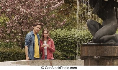 Young, happy, loving couple having date in the park. ...